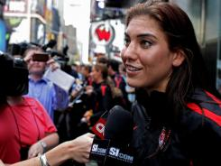 Hope Solo answers questions after she and members of the U.S. team arrived in New York's Times Square on Monday,  the day after the Americans lost to Japan in the Women's World Cup final.