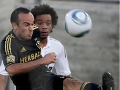 Los Angeles Galaxy forward Landon Donovan (left) wins the ball from Real Madrid's Marcelo during the first half of an exhibition match Saturday at Memorial Coliseum in Los Angeles.