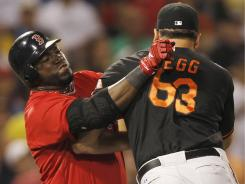 Orioles closer Kevin Gregg and Red Sox designated hitter David Ortiz began three-day suspensions Monday after a tussle on the pitcher's mound July 8. The Red Sox and Orioles began a three-game series Monday.