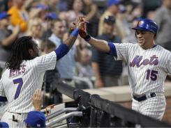 Carlos Beltran, right,  celebrates a two run home run with Jose Reyes.