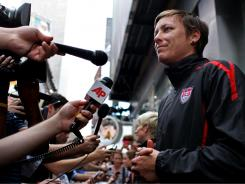 Abby Wambach talks to reporters in New York's Times Square on Monday after the team's return to the United States following a loss to Japan on Sunday in the Women's World Cup final.