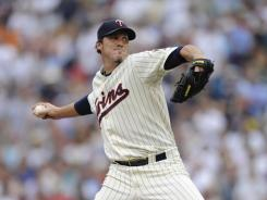 Joe Nathan, left, didn't pitch last season and had issues upon returning early this year. But since a disabled list stint, he has earned back his role as the Twins closer.