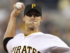 Pirates pitcher Charlie Morton tossed five shutout innings, striking out three and earning his eighth victory of the season Monday, as Pittsburgh beat the Reds 2-0.