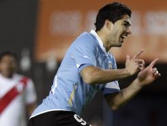 Uruguay's Luis Suarez celebrates after scoring his team's second goal during a Copa America semifinal against Peru.