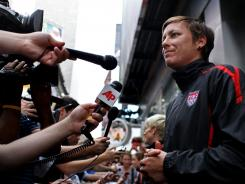 Abby Wambach talks to reporters in New York's Times Square on Monday, after the team's return to the USA following its loss to Japan on Sunday in the Women's World Cup final.