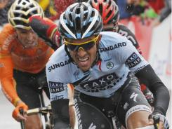 Three-time Tour de France winner Alberto Contador of Spain breaks away from the pack on the Col de Manse pass near Gap during the 16th stage of the Tour de France on Tuesday.