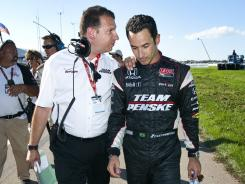 Helio Castroneves, right, is consoled by Team Penske spokesperson Merrill Cain after being penalized for an infraction in the final laps of the 2010 Honda Indy Edmonton race.