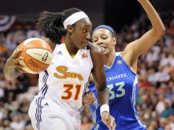 Connecticut Sun's Tina Charles, left, scored a game-high 24 points to beat the New York Liberty Tuesday.