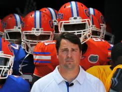 Florida coach Will Muschamp will face friends in Florida State's Jimbo Fisher and Tennessee's Derek Dooley during the upcoming season.