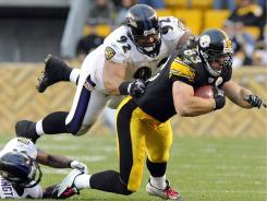 Ravens defensive tackle Haloti Ngata (92), tackling Steelers tight end Heath Miller on Oct. 3, uses his athleticism to make a mark beyond the line.