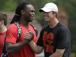 Atlanta Falcons rookie receiver Julio Jones, left, greeting quarterback Matt Ryan before an informal football workout, in Buford, Ga.