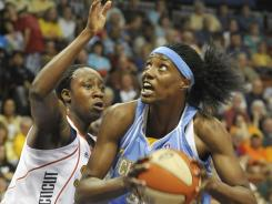 The Sky's Sylvia Fowles, right, and the Sun's Tina Charles, arguably the two best centers in the WNBA this year, both rank in the top five in points, rebounds and double-doubles this season.
