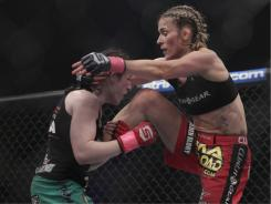 Marloes Coenen, right, fights Sarah Kaufman for the Strikeforce women's welterweight championship last October in San Jose. Coenen won by armbar submission in the third round.