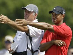 Tiger Woods and his caddie Steve Williams, left, began their partnership at the 1999 Bay Hill Invitational and won 72 times around the world, including 13 majors.