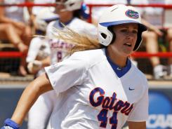 Florida's Brittany Schutte, rounds the bases following her grand slam against Alabama in the first inning of a Women's College World Series game in Oklahoma City on June 5.