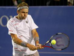 In his first outdoor match since Wimbledon, Mardy Fish cruised by Nicolas Mahut in straight sets.