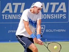 John Isner needed just 56 minutes to beat Yen-Hsun Lu 6-1, 6-2 at the Atlanta Tennis Championships.