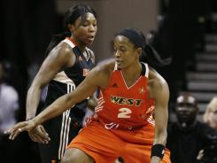 The West's Swin Cash, driving around the East's Cappie Pondexter, tallied 21 points and 12 rebounds in a losing effort to earn MVP honors. Pondexter had 17 points and seven assists to lead the East.