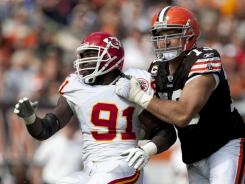 Cleveland Browns offensive tackle Joe Thomas handles Kansas City Chiefs linebacker Tamba Hali during their meeting in September.