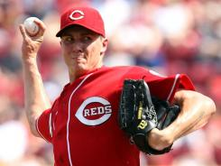 Starter Homer Bailey allowed two runs over six innings Saturday, pitching the Reds to an 11-2 victory over the Braves.