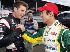 Takuma Sato, right, will start from the pole at Sunday's IndyCar Edmonton race, and Will Power will start second.