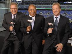 "Standing with ESPN colleague Mike Tirico in 2009, Ron Jaworski, left, is predicting a ""chaotic season"" and Jon Gruden, right, thinks teams will commit a lot of penalties, especially early in the season."