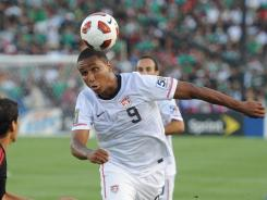 U.S. attacker Juan Agudelo attempts to head the ball past Mexico defender Ricardo Osorio during the 2011 CONCACAF Gold Cup final at the Rose Bowl on June 25. Mexico won 4-2.