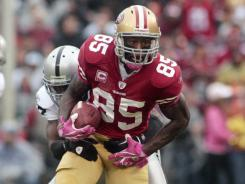 The 49ers' Vernon Davis, above, would like to someday be considered the greatest tight end, surpassing Tony Gonzalez.