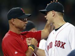 Jonathan Papelbon, right, congratulates Terry Francona after the closer nailed down the manager's 1,000th career win.