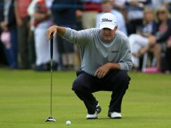 Russ Cochran lines up a putt on the 18th hole during the final round of the Senior British Open.