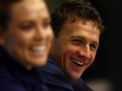 U.S. swimmer Ryan Lochte, right, could swim in as many as nine events at next year's Olympics.