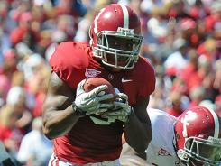A photo showing Alabama's Trent Richardson autographing items has prompted the school to send a cease-and-desist letter to a local store asking it to stop selling autographed items.