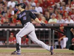 Carlos Beltran's sacrifice fly sparked the Mets to a four-run rally and a win over the Reds.