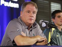 Oregon coach Chip Kelly says he'll address the NCAA investigation and related issues once the probe is complete.