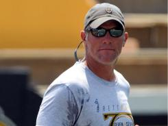 Brett Favre, seen here at  his football camp in Hattiesburg, Miss. in June,   is retired according to his agent Buzz Cook.