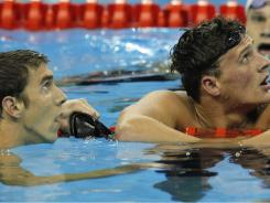 American Ryan Lochte (right) and teammate Michael Phelps look at the scoreboard after completing their men's 200-meter freestyle final at the FINA Swimming World Championships in Shanghai on Tuesday. Lochte won the gold medal as Phelps took the silver.