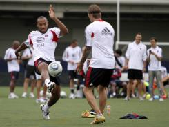 The Red Bulls' Thierry Henry, left, and the Galaxy's David Beckham practice on Monday in New York.