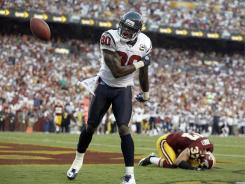 Houston Texans wide receiver Andre Johnson celebrates a touchdown during a September victory over Washington.