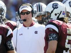 South Carolina quarterbacks coach G.A. Mangus has been suspended from his role after his arrest in Greenville, S.C.