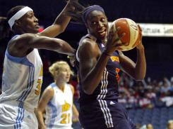 Tina Charles, right, had 21 points and held league scoring leader Sylvia Fowler, left, to six points below her average in Connecticut's win over Chicago.
