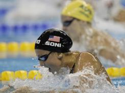 Rebecca Soni of the U.S. leads Australia's Liesel Jones on the way to winning the women's 100-meter breaststroke final at the FINA Swimming World Championships in Shanghai on Tuesday, Jones finished second.