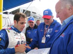From left to right, Vitor Meira, team manager Craig Baranouski, chief engineer Jeff Britton and A.J. Foyt discuss strategy prior to the Honda Edmonton Indy race.