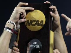 In order to get their hands on the national championship trophy next year, teams might have to survive replay reviews.