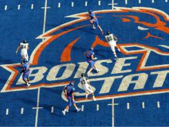 Other coaches in the Mountain West, Boise State's new league, felt that the blue uniforms on a blue field gave the Broncos a competitive advantage.