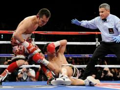 Bantamweight champion Nonito Donaire, shown knocking out Fernando Montiel last February, has inked a multi-year contract extension to stay with Top Rank Promotions.