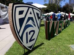 The Pac-12 Conference announced plans for both six regional and a national television network.