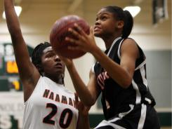 Moriah Jefferson, right, drives for a layup on Feb. 2, 2010 at Garland Naaman Forest. On Thursday Jefferson scored a team-leading 22 points for DFW T-Jack Elite.