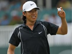 Anthony Kim tips the ball to the crowd after a birdie on the 17th hole Saturday. His 62 gave him a one-stroke lead going into the final at the Greenbrier Classic.