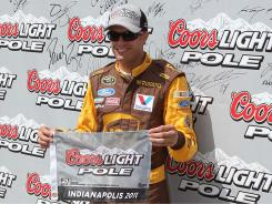 David Ragan celebrates winning the pole for Sunday's Brickyard 400, his second Sprint Cup pole of the season.
