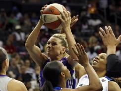 Phoenix Mercury's Penny Taylor, center, scored a game-high 29 points to lead the Mercury past the Liberty Saturday.